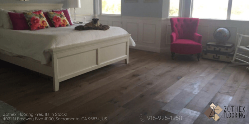 Oak Hardwood floor with white bed and pink chair in the corner