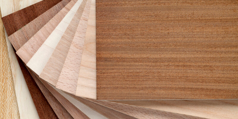 Close up of sample pack of wooden flooring laminate