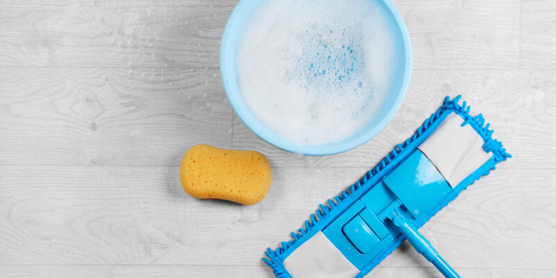 Cleaning disinfection kit on a white laminate floor