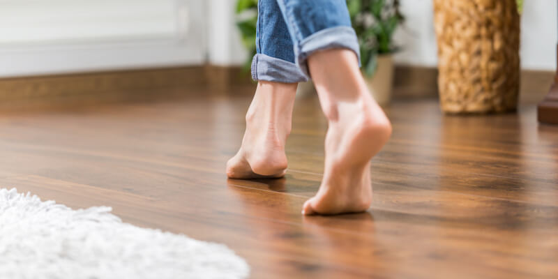 Young woman walking in the house on the warm floor
